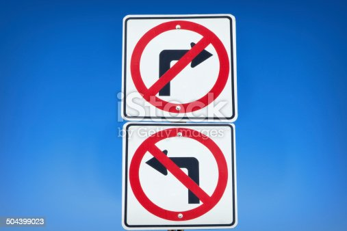Conflicting do not turn signs.