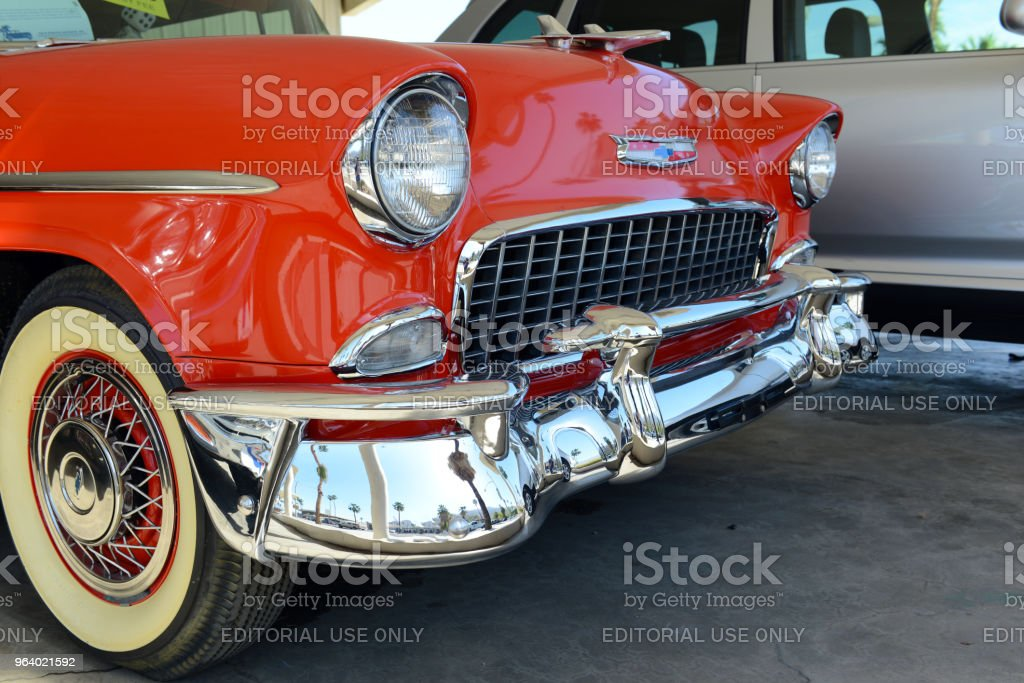 While electrification of vehicles is a popular theme, cars like The 1955 Chevy Bel Air remain popular due to their clean lines and iconic symbols of American automobiles - Royalty-free Bumper Stock Photo