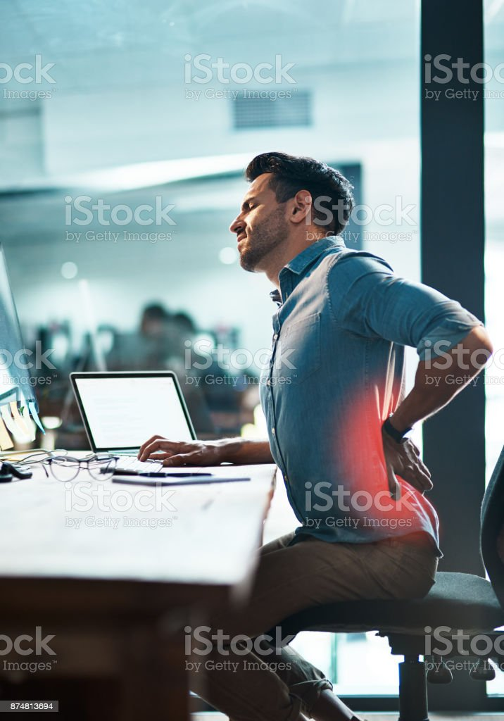 While he supports business, what's supporting his back? stock photo