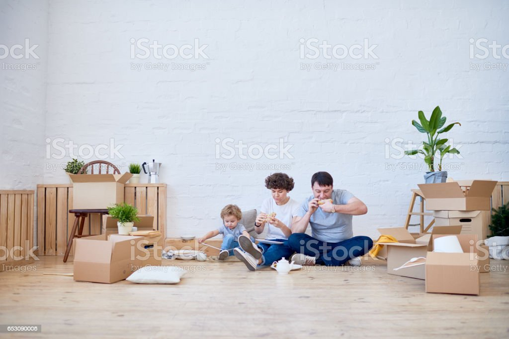 While moving boxes still unpacked stock photo