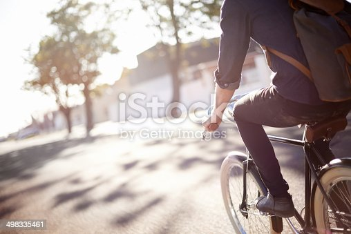 A young man riding a bicycle outdoorshttp://195.154.178.81/DATA/i_collage/pi/shoots/783453.jpg