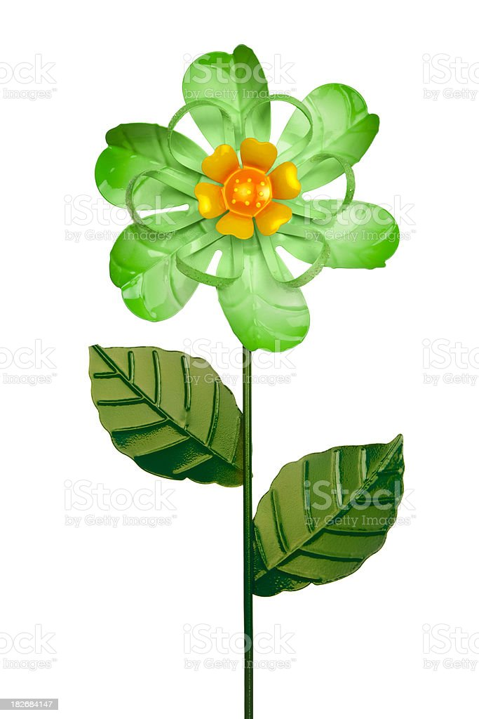 Whimsical Green and Yellow Metal Whirligig Garden Flower, White Background royalty-free stock photo