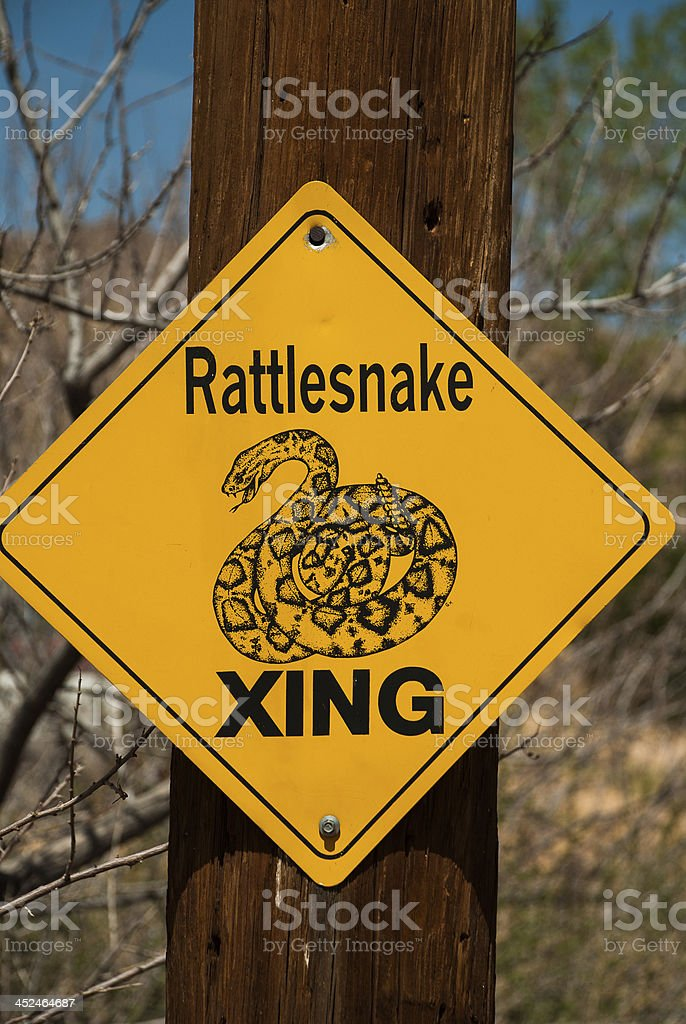Whimsical sign Rattlesnake Xing near Hackberry Springs Arizona stock photo