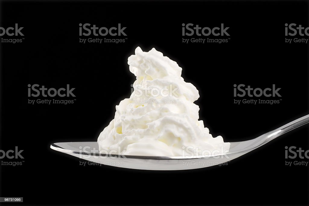 Whipped cream on spoon royalty free stockfoto