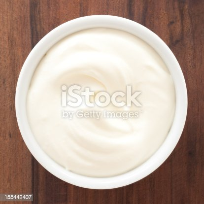 Top view of white bowl full of whipped cream
