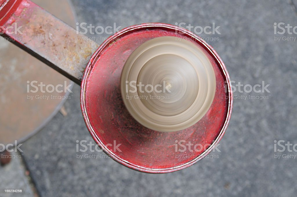 Whipping top spinning on iron plate stock photo