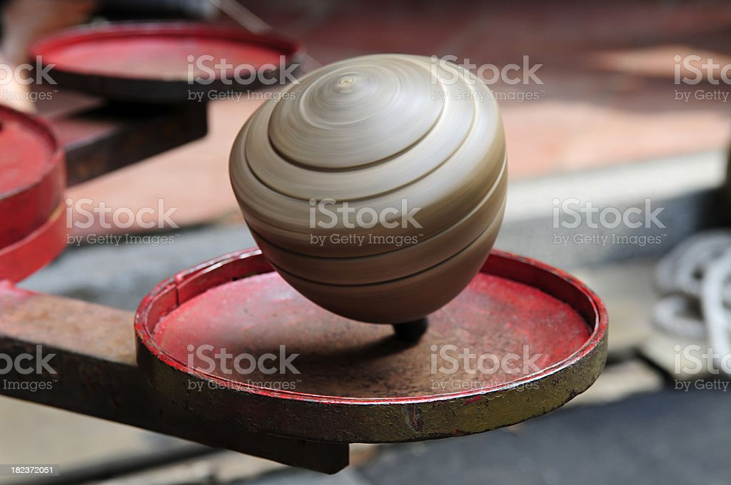 Whipping top spinning stock photo