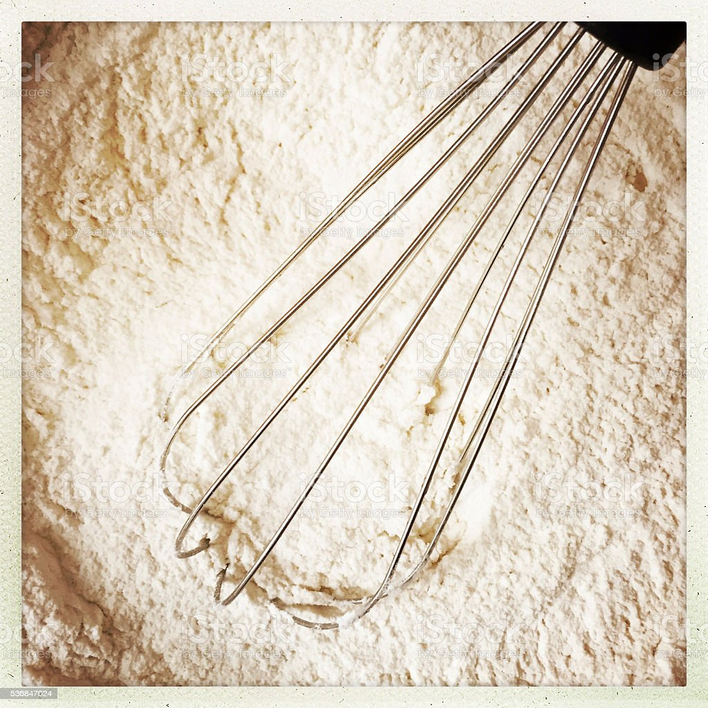 Whisk in Flour stock photo