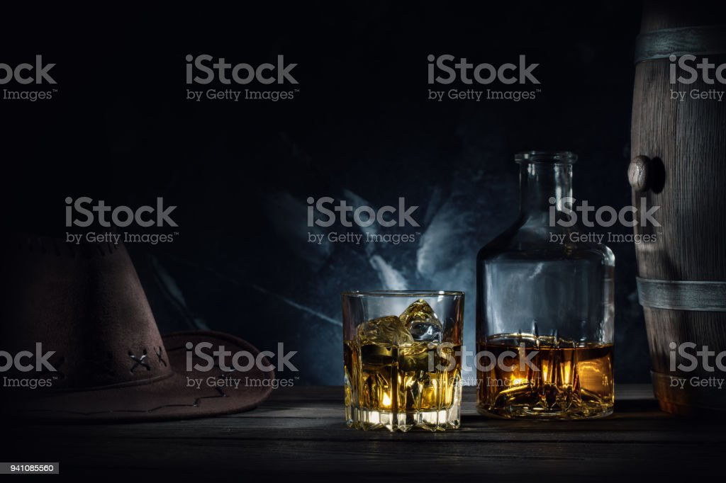 Whiskey and hat and barrel on dark background stock photo