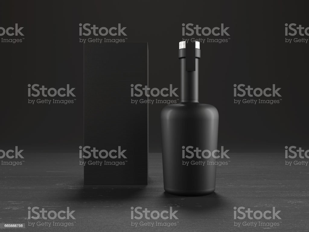 Whiskey bottle and packaging on black wood desk stock photo