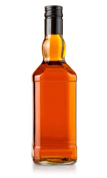 whiskey bottle on white stock photo