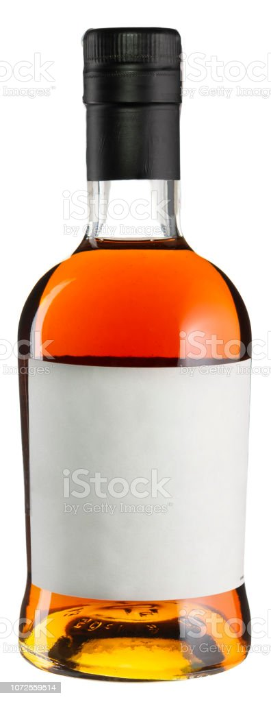 Whiskey bottle with blank label isolated on white. Strong alcoholic drink stock photo