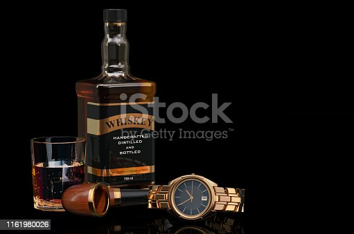 istock Whiskey bottle with smoking pipe and wrist watch, 3D rendering on black background 1161980026