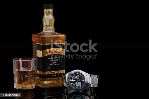 istock Whiskey bottle with Wrist Watch for men, 3D rendering on black background 1160455041
