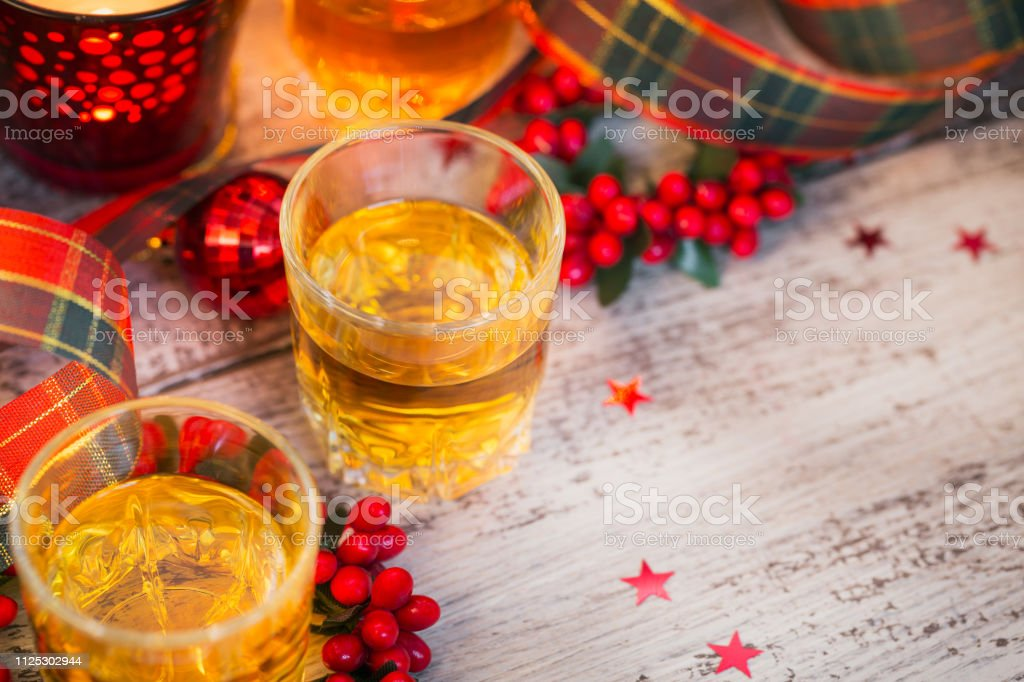 Christmas Liquor.Whiskey Brandy Or Liquor Shot And Christmas Decorations Stock Photo Download Image Now