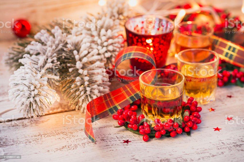 Christmas Liquor.Whiskey Brandy Or Liquor Shot And Christmas Decorations