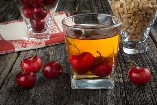 Whiskey Cocktail With Cherries and Peanuts