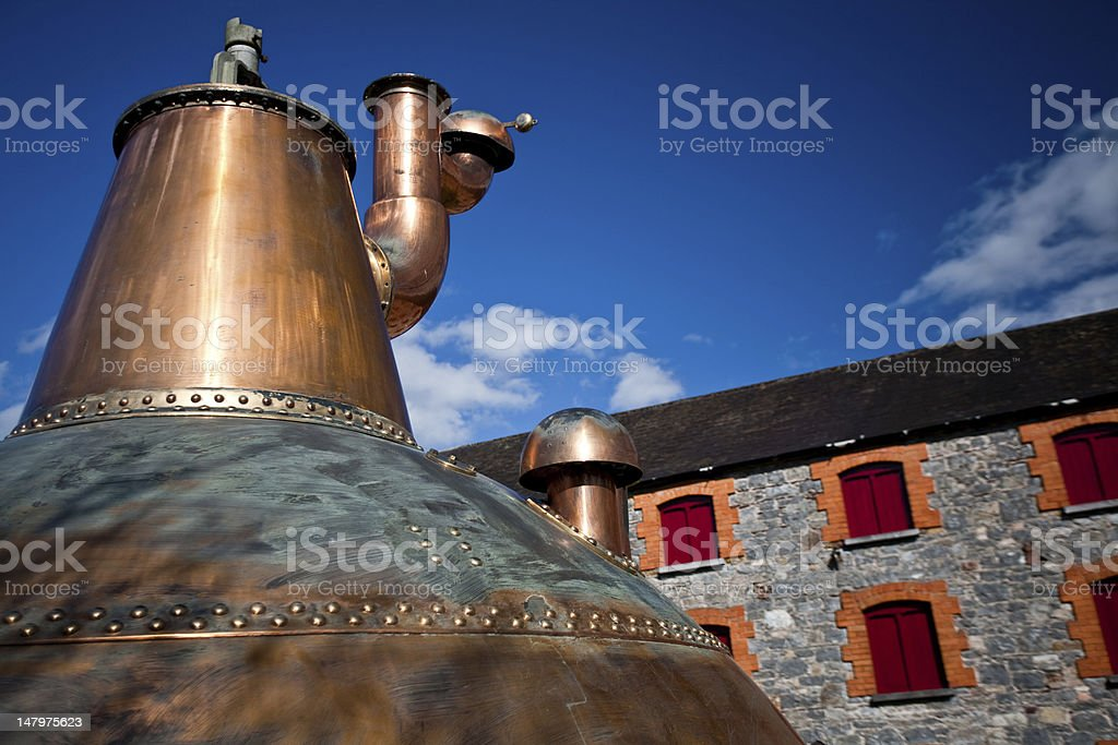 Whiskey distillery Old copper washback in Ireland royalty-free stock photo