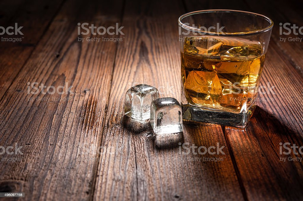 Whiskey drink on wood stock photo
