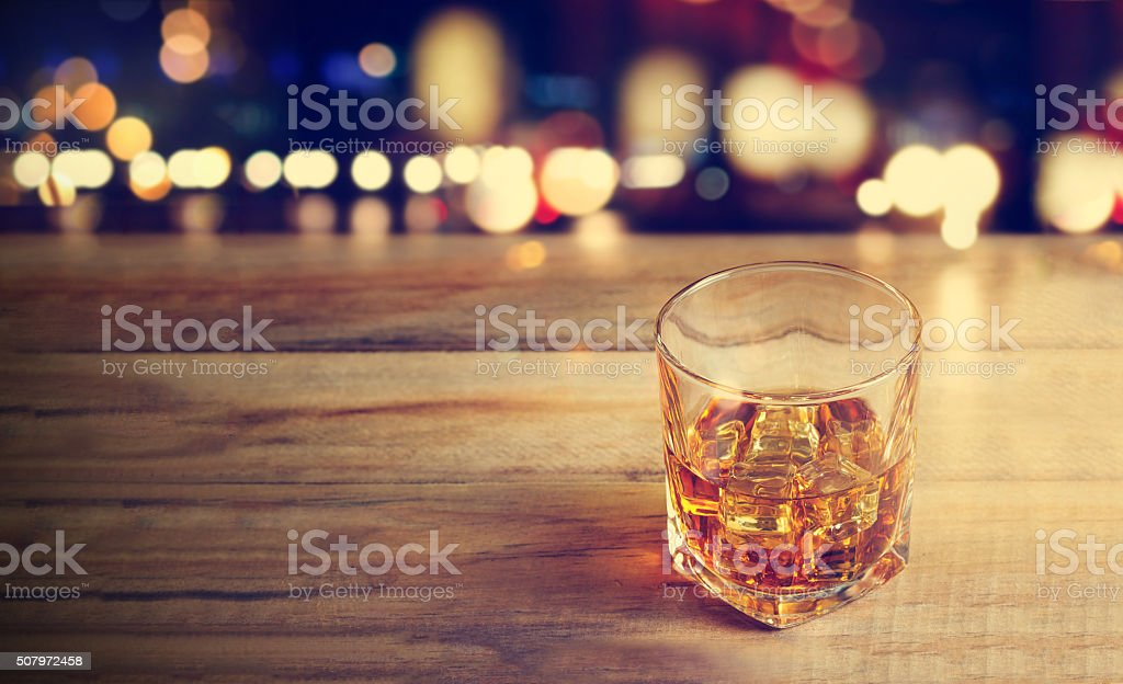 Whiskey drink on wooden dark background stock photo