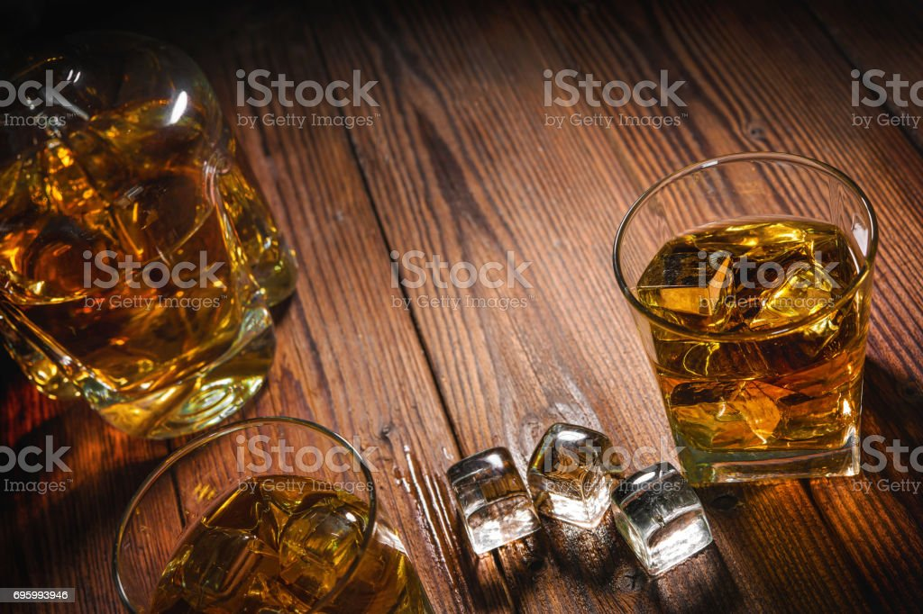 Whiskey drinks on wood stock photo