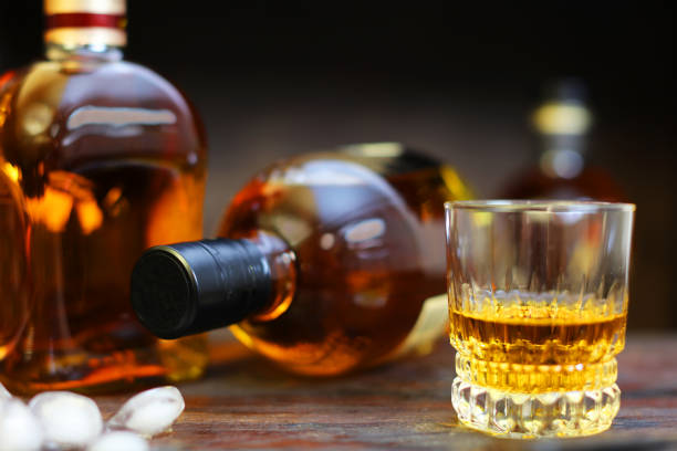 Whiskey Glass and Generic Bottles stock photo