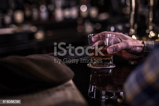 istock Whiskey glass in hand 916088290