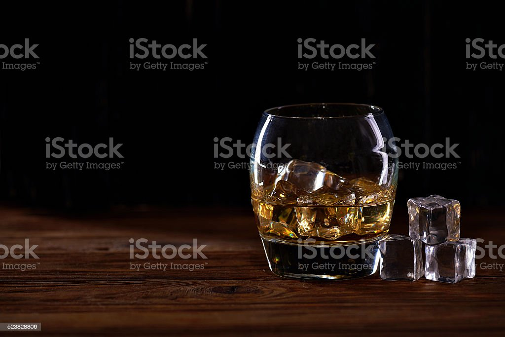 whiskey in a flass with ice stock photo