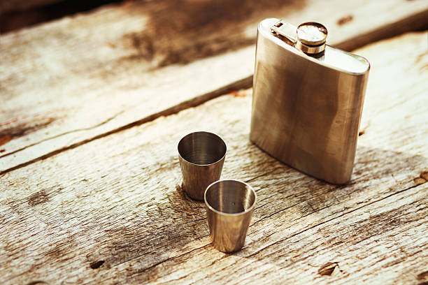 Whiskey in a hip flask stock photo