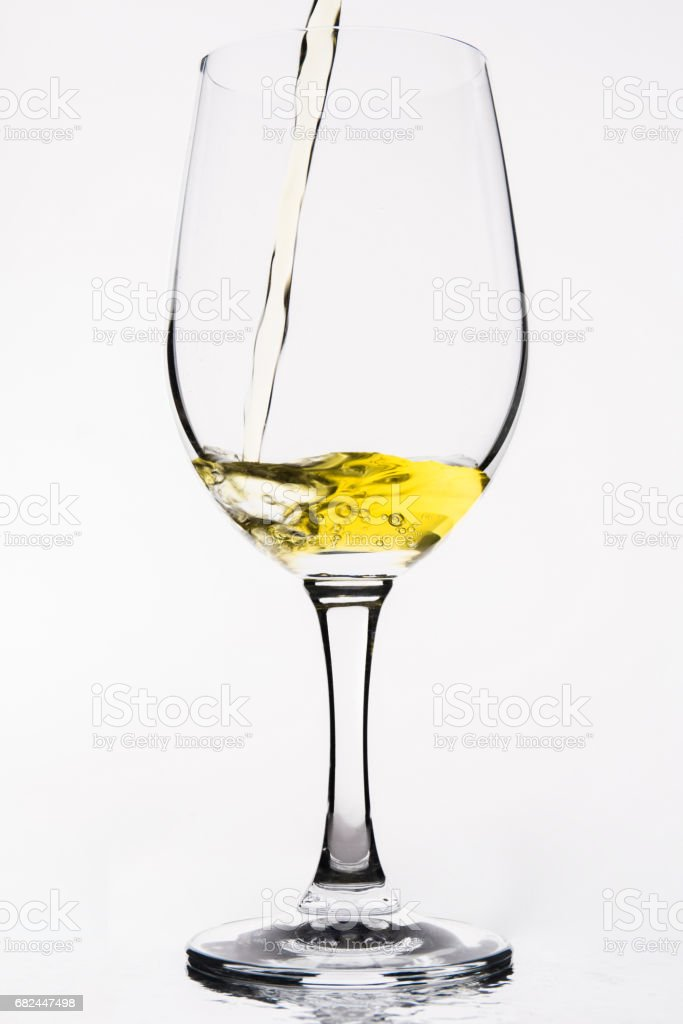 Whiskey in a  wine glass isolated on white - Yellow royalty-free stock photo
