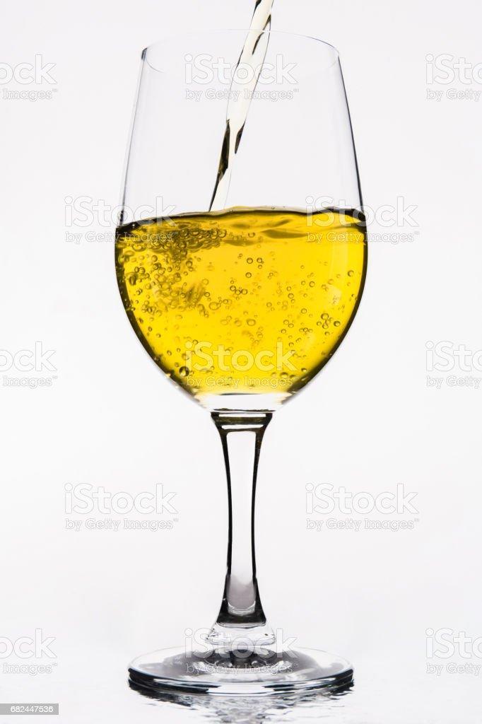 Whiskey in a  wine glass isolated on white - Yellow foto de stock libre de derechos
