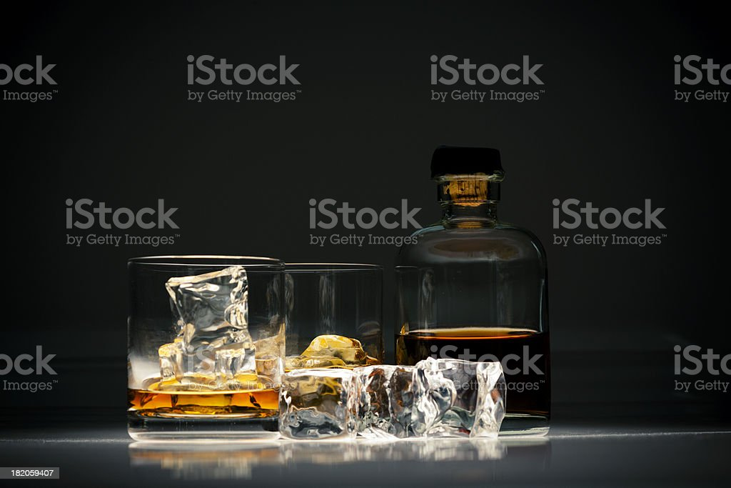 Whiskey in glass with ice stock photo