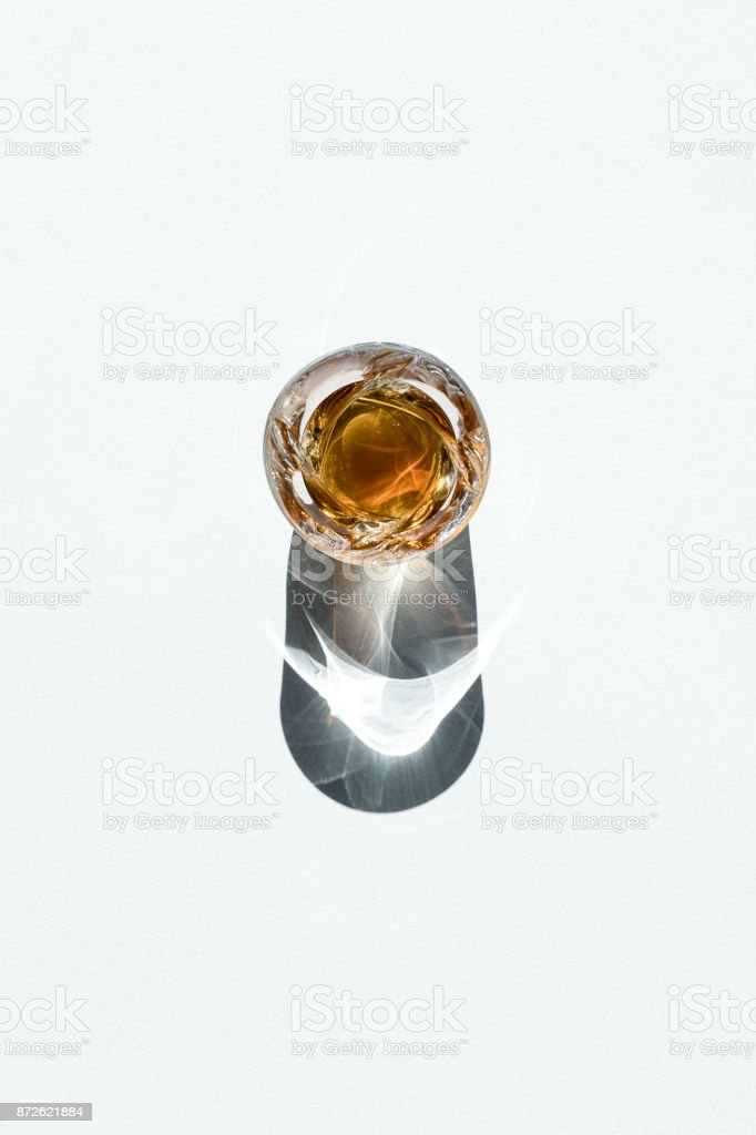 whiskey in glass with shadow stock photo
