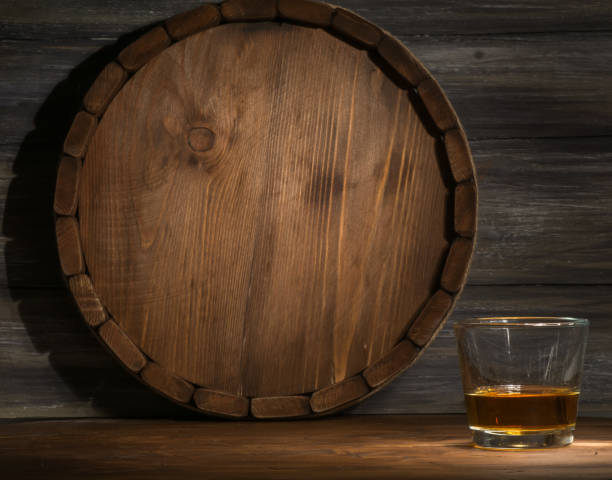whiskey on a wooden - barrel stock pictures, royalty-free photos & images