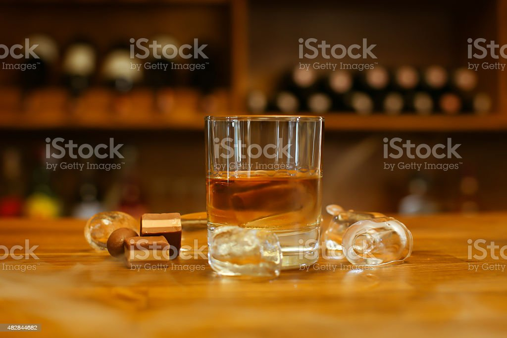 whiskey on bar table - stock image stock photo