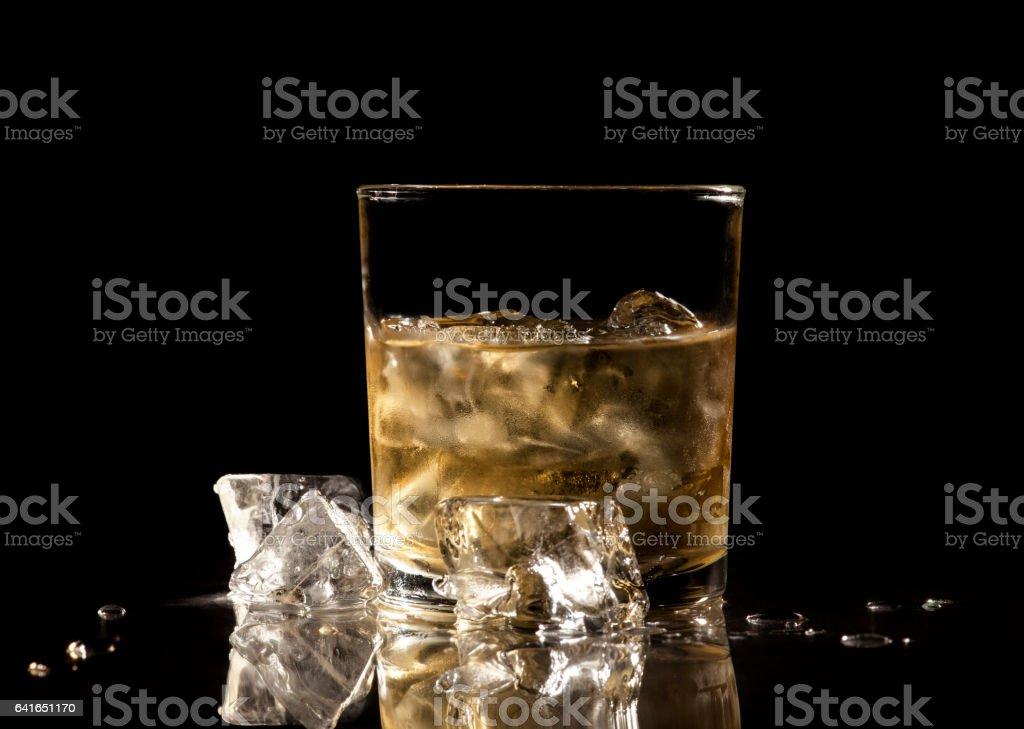 Whiskey on black background stock photo