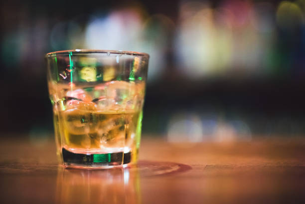 whiskey on the rocks - dipsomania stock pictures, royalty-free photos & images