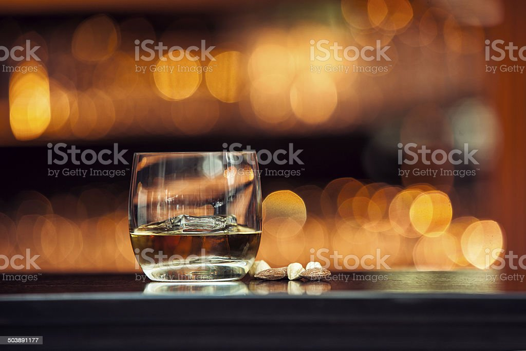 Whiskey on wood bar stock photo