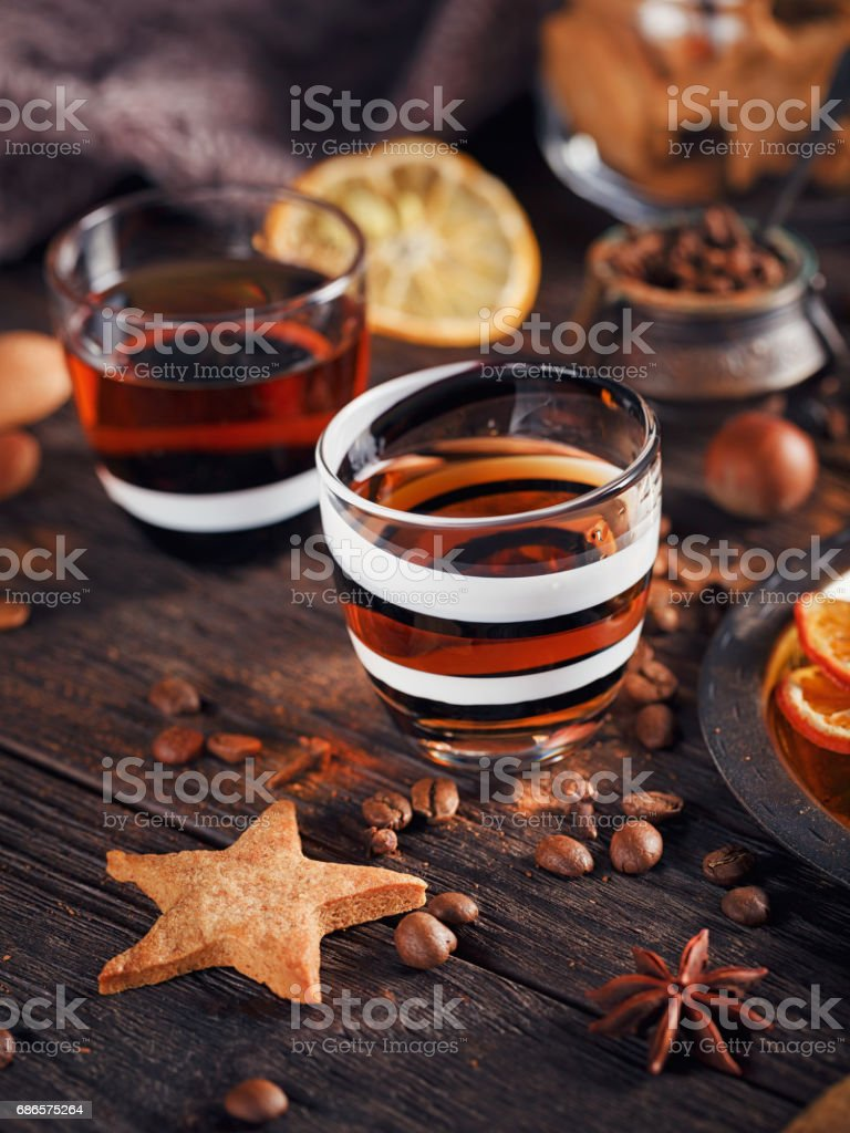 Whiskey or liqueur, cookies, spices and decorations on wooden background. zbiór zdjęć royalty-free