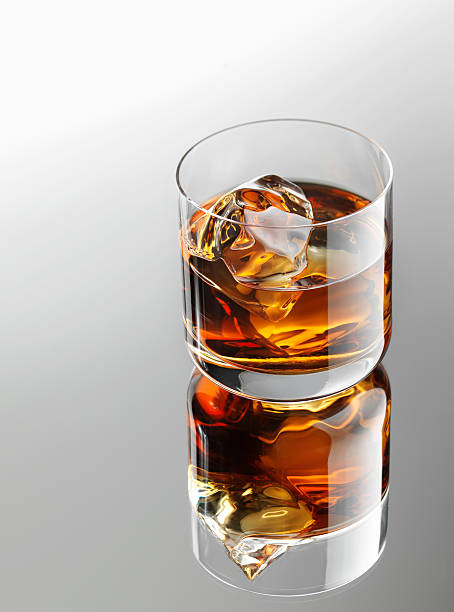 Whiskey over ice cubes stock photo