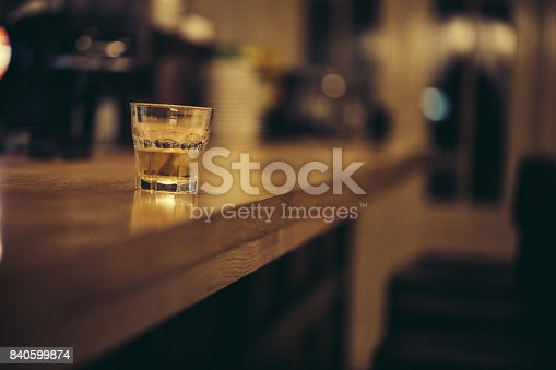 Glass of whiskey on a bar counter