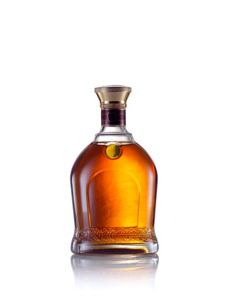 whiskey close up view of whiskey bottle on white back. brandy stock pictures, royalty-free photos & images