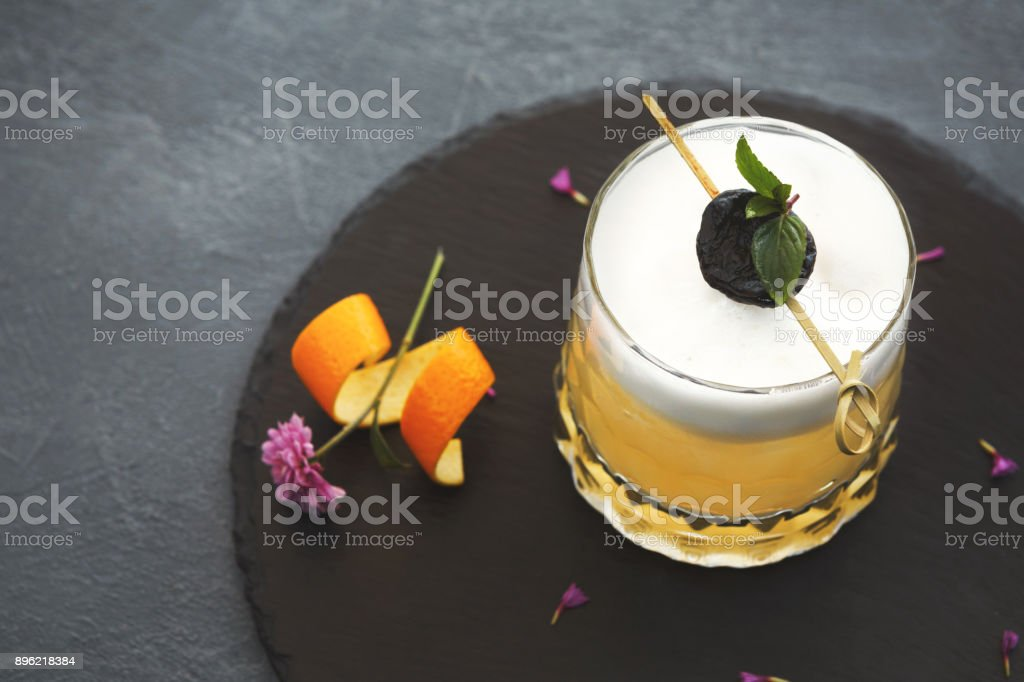 Whiskey sour cocktail served on restaurant table stock photo