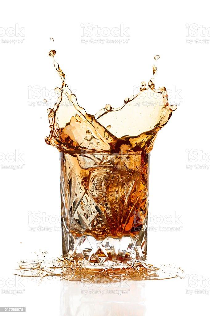 Whiskey Splash Isolated on White Background stock photo