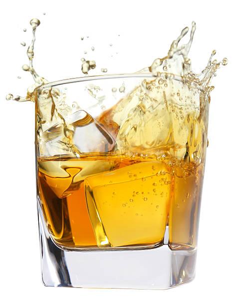 whiskey splash stock photo