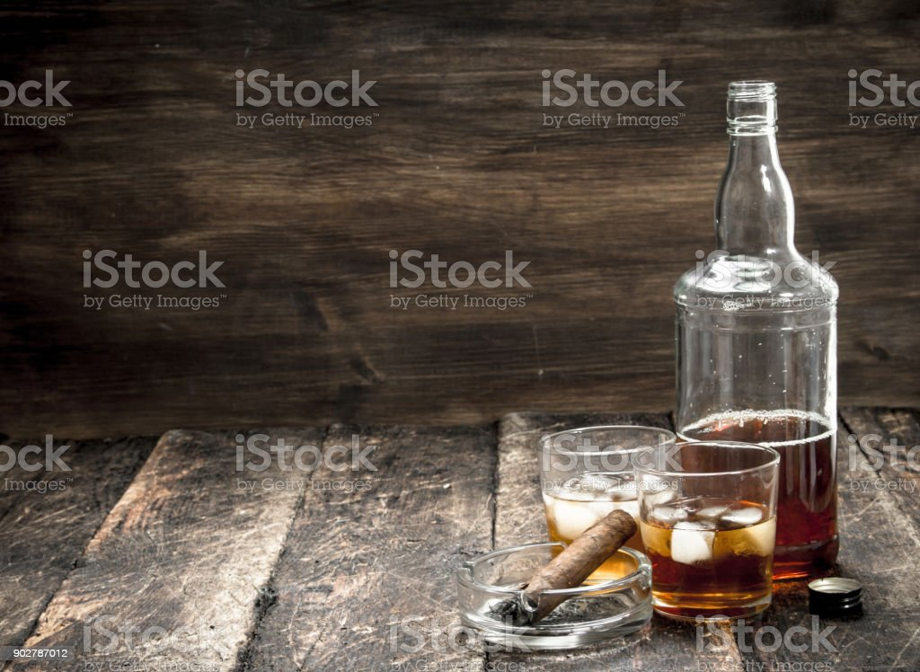 Whiskey with ice and a cigar. stock photo