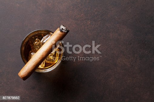istock Whiskey with ice and cigar 827879552