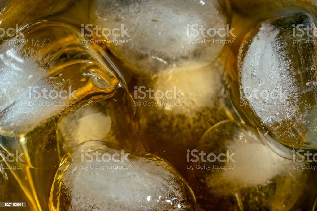 Whiskey with ice cubes, closeup stock photo