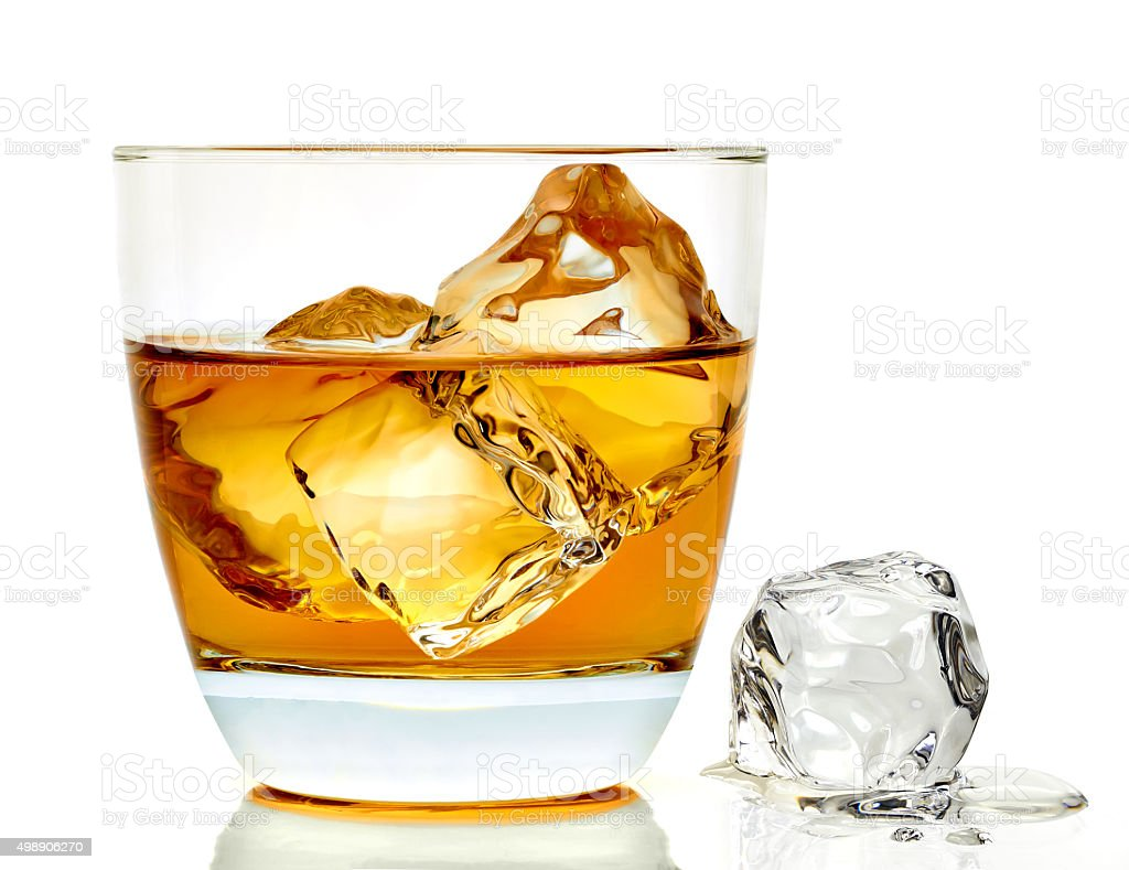 Whiskey with ice cubes stock photo