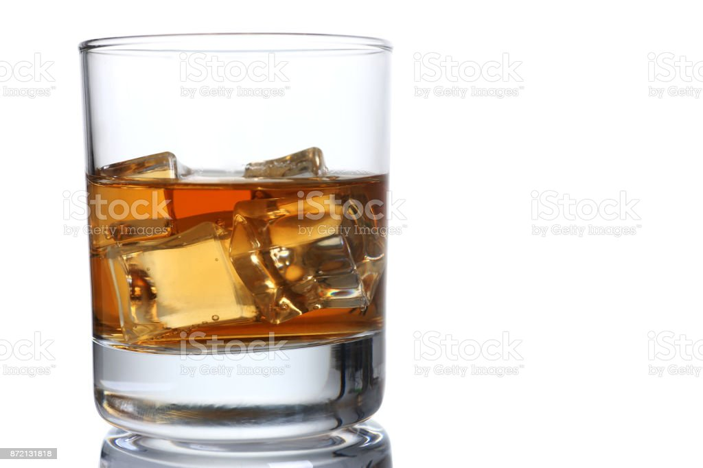Whiskey with ice in a glass isolated stock photo